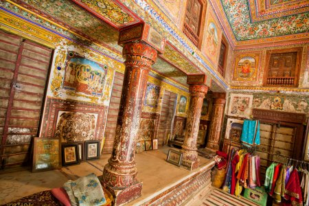 Interior of historical mansion Haveli with colorful frescoes in Rajasthan