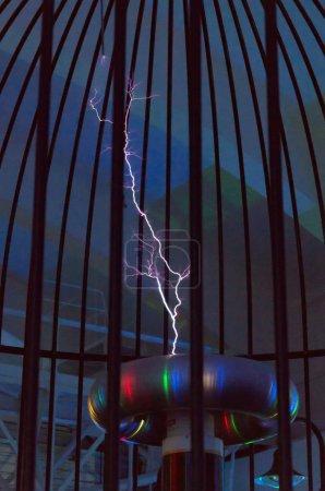 Resonant transformer in work. Tesla coil.