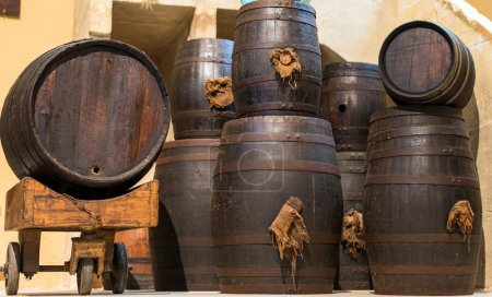 Wine barrels stacked in the old cellar.