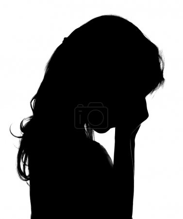 Silhouette of crying little girl.
