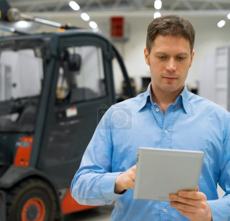 Handsome supervisor with tablet pc at warehouse.