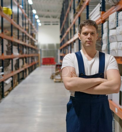 Handsome supervisor with at the warehouse. Space for text.