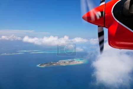 Detail of sea plane engine above Maldives islands
