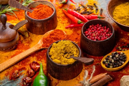 Various spices in wooden bowls