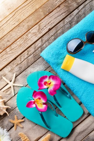 Photo for Beach accessories on wooden background, copyspace for text - Royalty Free Image