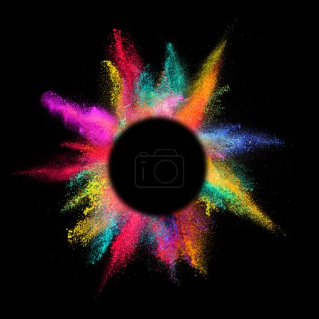 Explosion of colored powder on black background