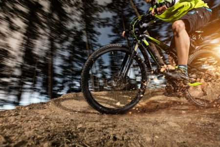 Low angle view of mountain biker riding on trail