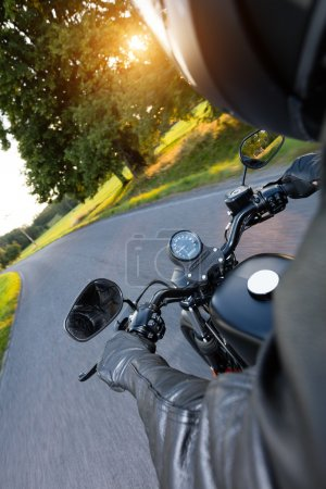 Motorcycle driver riding on motorway
