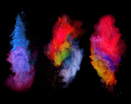 Explosions of colored powder on black background