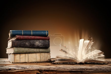 Photo for Old books on wooden planks with blur shimmer background - Royalty Free Image
