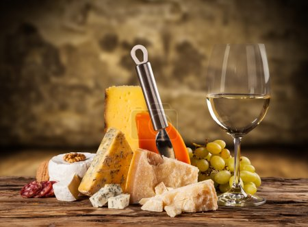 Various kind of cheese with white wine...