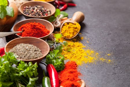 Various spices on black stone