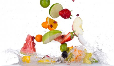 Mix fruit in water splashes on black background