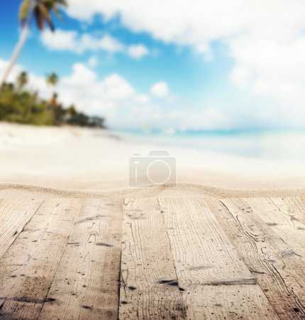 Empty wooden pier with view on sandy beach. Free s...