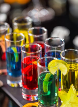 Colored alcoholic shots on bar counter