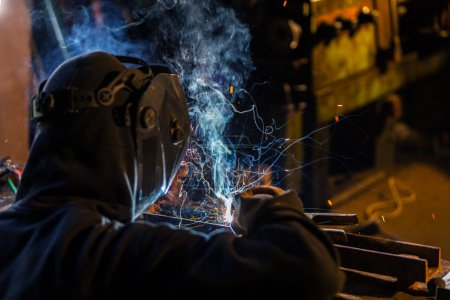 Welder in action. Low depth of focus