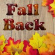 Fall Back, Fall Leaves over a distressed wood back...