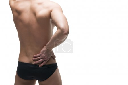 Kidney pain. Man with backache. Pain in the human body. Muscular male body. Isolated on white background