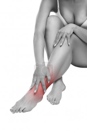 Woman with pain in the joint, massage of female feet, ache in the human body isolated on white background