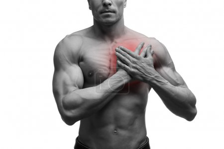 Heart attack, middle aged muscular man with chest pain isolated on white background