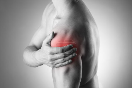 Man with pain in shoulder. Pain in the human body