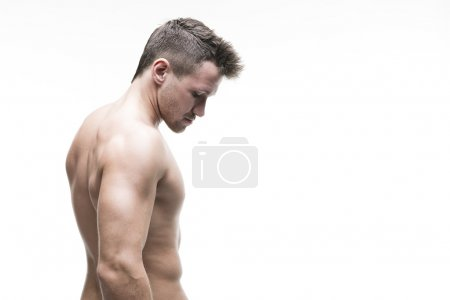 Photo for Handsome muscular bodybuilder posing on white background. Isolated studio shot with copy space. Sexy male body - Royalty Free Image