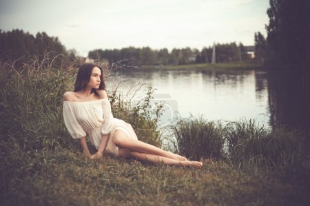 Beautiful lady at river