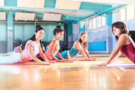 Photo for A group of women in sport dress at pilates and yoga exercise - Royalty Free Image