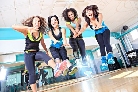 Photo for Group of  women in sport dress jumping at fitness dance excercise or aerobics - Royalty Free Image