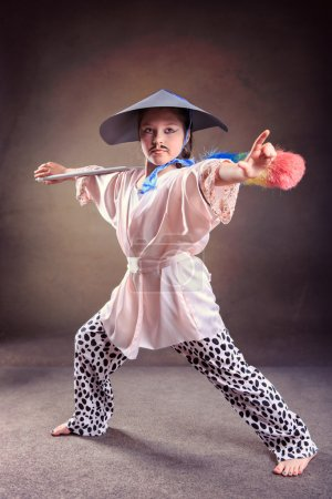 Young girl in self-made shaolin fighter dress...