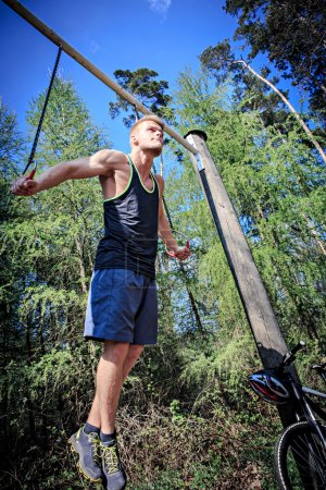 Photo for Young man at training on a fitness trail - Royalty Free Image