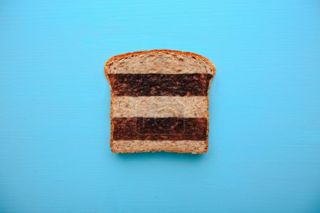 Photo for Toast with dark and light lines for good and bad luck isolated on blue background - Royalty Free Image