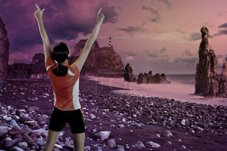 sport woman on the rocky coast