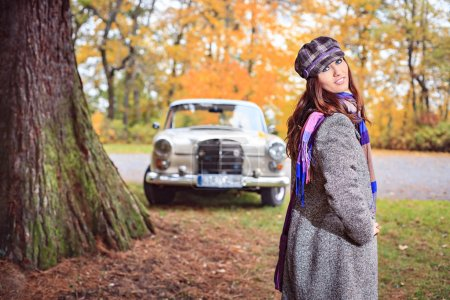 Photo for A young woman in front of Post-War classic car - Royalty Free Image