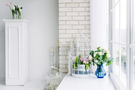 Photo for Fresh flowers are tulips and roses at the window. Decor Studio - Royalty Free Image