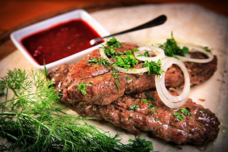 Lula kebab with onions and greens