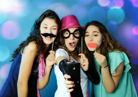Photo for Portrait of playful girls on illuminated  background - Royalty Free Image