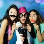 Portrait of playful girls on illuminated  backgrou...