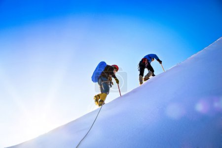 Group of climbers reaching the summit.