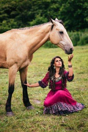 Beautiful gypsy in violet dress