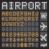Set of letters on a mechanical timetable airport symbols