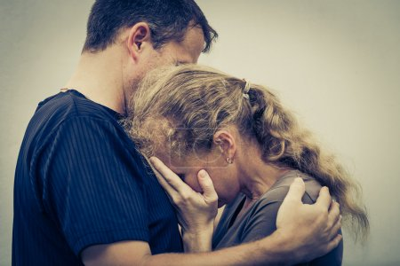 Photo for Sad woman hugging her husband - Royalty Free Image