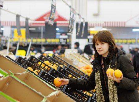 Young customer buying fruit