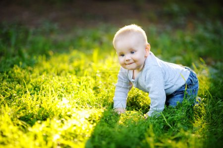 Little baby boy at the sunny park