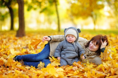 Young mother with her baby in autumn