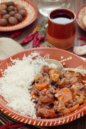 typical portuguese dish feijoada with rice in ceramic bowl