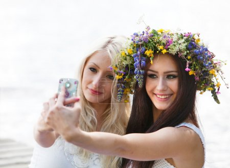 Friends taking selfie with phone