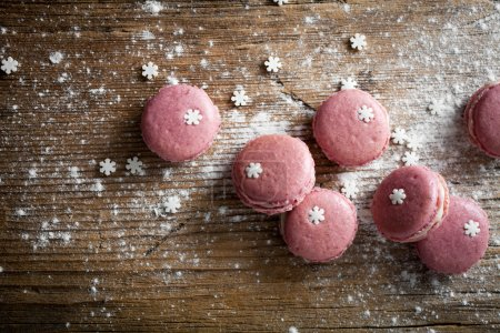 Photo for Christmas macaroons on wooden background, close-up - Royalty Free Image