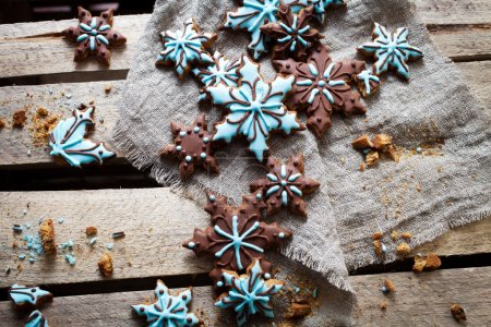 Photo for Christmas cookies with brown and blue frosting - Royalty Free Image