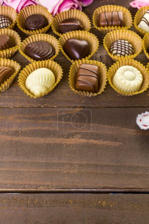 Assorted chocolates with pink roses